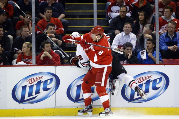 Detroit Red Wings left wing Justin Abdelkader (8) checks Chicago Blackhawks defenseman Michal Rozsival (32) in the first period in game four of the second round for the 2013 Stanley Cup Playoffs at Joe Louis Arena.