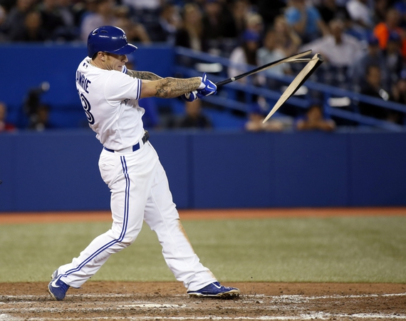 Toronto Blue Jays third baseman Brett Lawrie (13) gets a broken bat single in the eighth inning against the Baltimore Orioles at the Rogers Centre. Toronto defeated Baltimore 12-6.