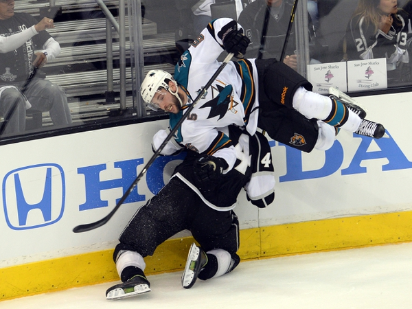 San Jose Sharks defenseman Jason Demers (5) gets called for boarding on Los Angeles Kings defenseman Robyn Regehr (44) in the second period of game five of the second round of the 2013 Stanley Cup Playoffs at the Staples Center.