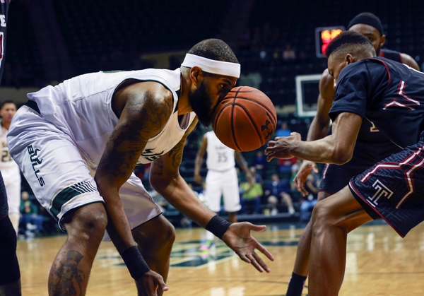 South Florida Bulls center Jaleel Cousins (15) goes after the loose ball during the first half against the Temple Owls at USF Sun Dome.