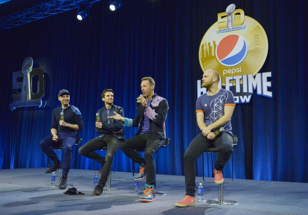 Recording artists from left Jonny Buckland , Guy Berryman , Chris Martin and Will Champion of Coldplay speak during the Super Bowl 50 halftime show press conference at Moscone Center.