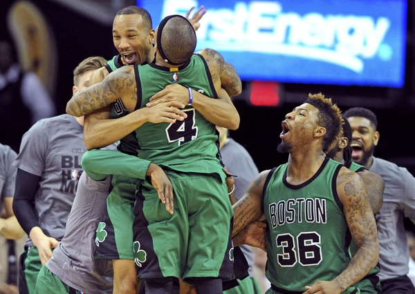 Boston Celtics guard Avery Bradley (0) celebrates with guard Isaiah Thomas (4) after making a three-point shot to end the game and beat the Cleveland Cavaliers at Quicken Loans Arena. The Celtics won 104-103.
