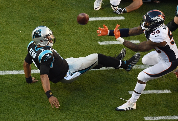 Denver Broncos outside linebacker Von Miller (58) strips the ball from Carolina Panthers quarterback Cam Newton (1) in Super Bowl 50 at Levi's Stadium.