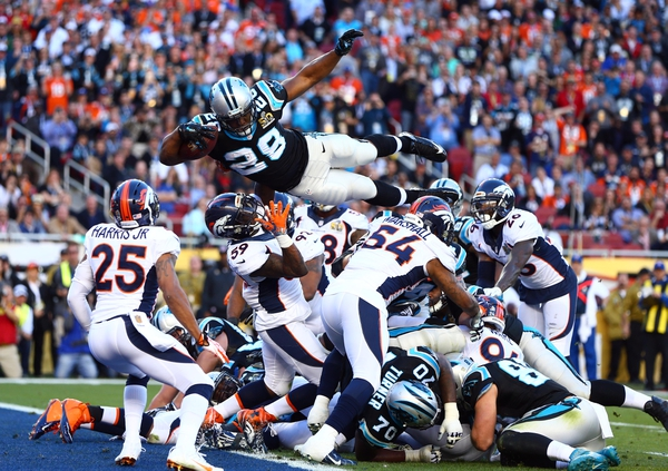 Carolina Panthers running back Jonathan Stewart (28) dives over the pile of defenders for a touchdown against the Denver Broncos in the second quarter in Super Bowl 50 at Levi's Stadium.