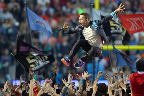 Coldplay singer Chris Martin performs during halftime in Super Bowl 50 at Levi's Stadium.