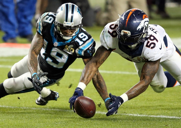 Denver Broncos inside linebacker Danny Trevathan (59) recovers a fumble against Carolina Panthers wide receiver Ted Ginn (19) during the third quarter in Super Bowl 50 at Levi's Stadium.