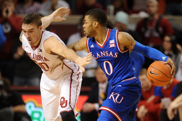 Kansas Jayhawks guard Frank Mason III (0) drives to the basket against Oklahoma Sooners forward Ryan Spangler (00) during the second half at Lloyd Noble Center.