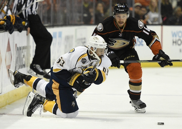 Nashville Predators center Mike Ribeiro (63) attempts to pass the puck while under pressure by Anaheim Ducks center Ryan Garbutt (16) during the first period in game five of the first round of the 2016 Stanley Cup Playoffs at Honda Center.