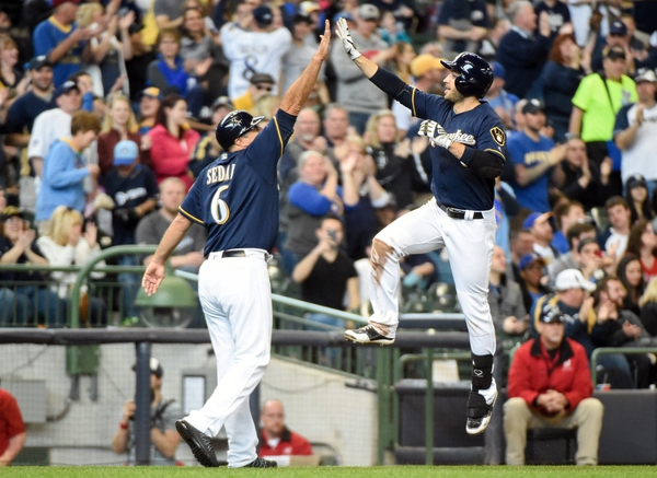 Milwaukee Brewers left fielder Ryan Braun (8) celebrates with third base coach Ed Sedar after hitting a solo home run in the fourth inning against the Philadelphia Phillies at Miller Park.