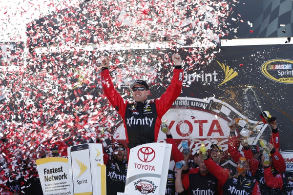 Sprint Cup Series driver Carl Edwards (19) celebrates in Victory Lane after winning the Toyota Owners 400 at Richmond International Raceway.