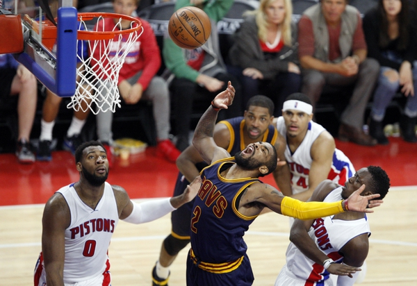 Cleveland Cavaliers guard Kyrie Irving (2) loses the ball against Detroit Pistons center Andre Drummond (0) and guard Reggie Jackson (1) during the fourth quarter in game four of the first round of the NBA Playoffs at The Palace of Auburn Hills. Cavs win 100-9 ...