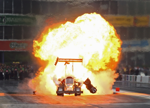 NHRA top fuel driver Terry McMillen explodes an engine on fire during the Spring Nationals at Royal Purple Raceway.