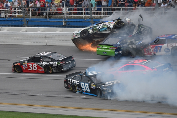 NASCAR Sprint Cup Series driver Kevin Harvick (4) and Ricky Stenhouse Jr. (17) and AJ Allmendinger (47) and Martin Truex Jr. (78)  and Cole Whitt (98) wreck on the last lap during the GEICO 500 at Talladega Superspeedway.