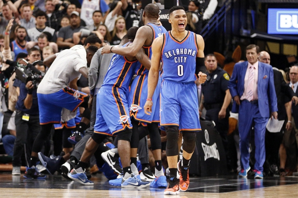 Oklahoma City Thunder point guard Russell Westbrook (0) and teammates celebrate a victory over the San Antonio Spurs in game two of the second round of the NBA Playoffs at AT&T Center.