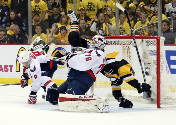 Pittsburgh Penguins left wing Carl Hagelin (62) crashes into Washington Capitals goalie Braden Holtby (70) during the first period in game four of the second round of the 2016 Stanley Cup Playoffs at the CONSOL Energy Center.