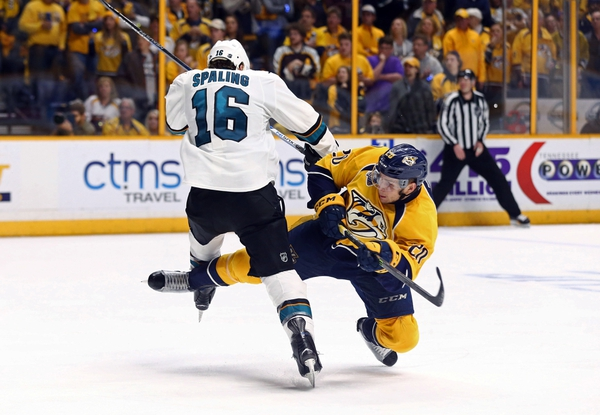 San Jose Sharks center Nick Spaling (16) checks Nashville Predators left wing Miikka Salomaki (20) during the second overtime period in game four of the second round of the 2016 Stanley Cup Playoffs at Bridgestone Arena.