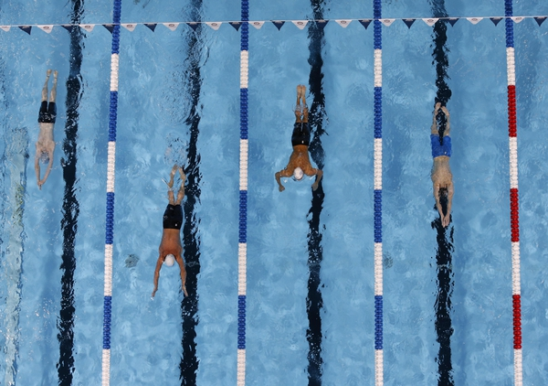 Ryan Lochte (second left) leads during the men's 400m individual medley preliminary heats in the U.S. Olympic swimming team trials at CenturyLink Center.