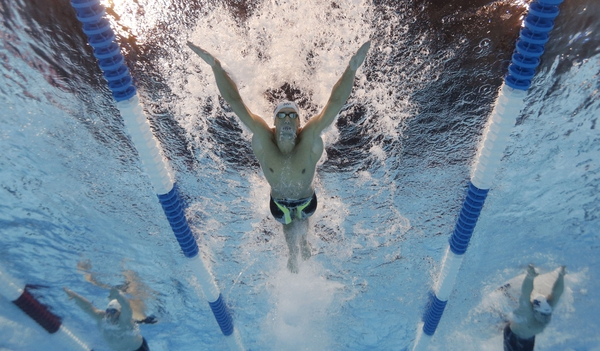 Michael Phelps swims during the men's butterfly 200m preliminary heats in the U.S. Olympic swimming team trials at CenturyLink Center.