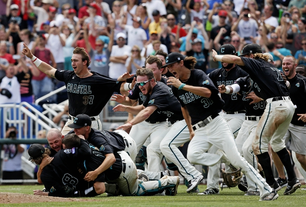 Coastal Carolina Chanticleers players celebrate after winning the championship against the Arizona Wildcats in game three of the College World Series championship series at TD Ameritrade Park.