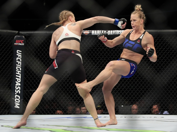 Holly Holm (red gloves) competes against Valentina Shevchenko (blue gloves) in their women's bantamweight bout during UFC Fight Night at United Center.