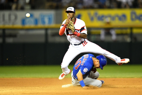 Chicago White Sox shortstop Tim Anderson (12) attempts a double play after getting Chicago Cubs left fielder Willson Contreras (40) out off of Chicago Cubs center fielder Jason Heyward's (not pictured) ground ball during the eighth inning at U.S. Cellular Fiel ...