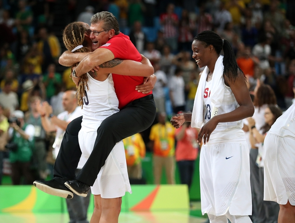 USA center Brittney Griner (15) celebrates with USA head coach Geno Auriemma (USA) after beating Spain in the women's basketball gold medal match during the Rio 2016 Summer Olympic Games at Carioca Arena 1.