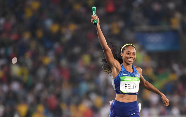 Allyson Felix (USA) celebrates in the women's 4x400m final during the Rio 2016 Summer Olympic Games at Estadio Olimpico Joao Havelange.