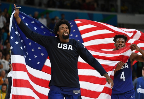 USA center DeAndre Jordan (6) and USA forward Jimmy Butler (4) celebrate winning the gold medal in the men's gold game during the Rio 2016 Summer Olympic Games at Carioca Arena 1.
