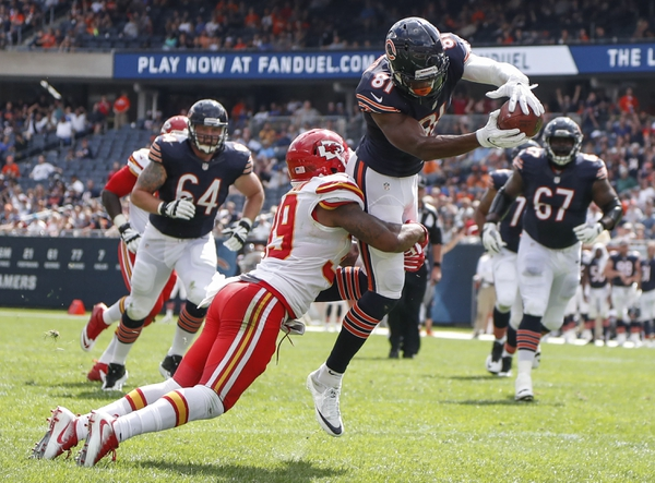 Chicago Bears wide receiver Cameron Meredith (81) goes for a touchdown against Kansas City Chiefs safety Jeron Johnson (39) during the second half of the preseason game at Soldier Field. The Chiefs won 23-7.