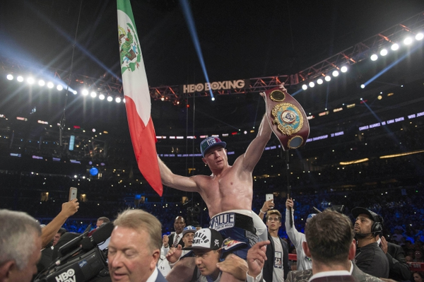 Canelo Alvarez celebrates his win over Liam Smith (not pictured) during the WBO middleweight boxing world championship bout at AT&T Stadium.