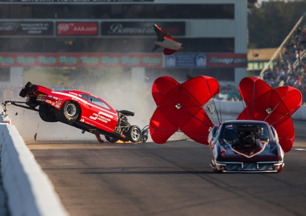 NHRA pro mod driver Jay Payne goes airborne as he crashes alongside Chuck Little during qualifying for the Midwest Nationals at Gateway Motorsports Park. Payne walked away from the accident.