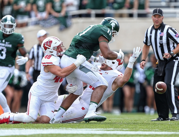 Michigan State Spartans tight end Jamal Lyles (11) has pass broken up by Wisconsin Badgers linebacker Jack Cichy (48) during the first quarter of a game at Spartan Stadium.