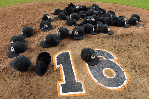 Hats of the Miami Marlins lay on the pitchers mound after the game to honor teammate starting pitcher Jose Fernandez at Marlins Park.