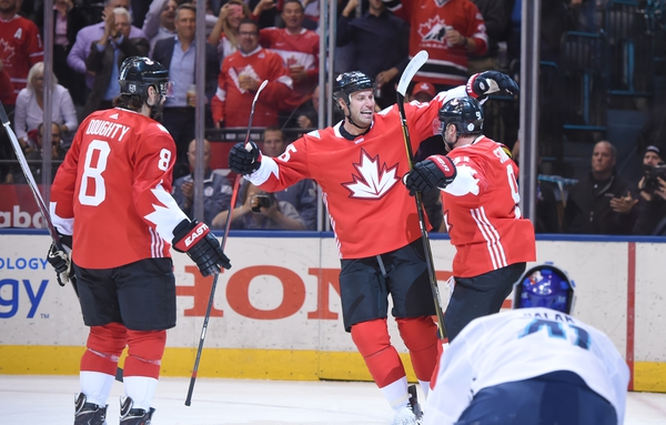 Team Canada center Steven Stamkos (91) celebrates with teammates Ryan Getzlaf (15) and Drew Doughty (8) after scoring a goal against the Team Europe during the first period in game one of the World Cup of Hockey final at Air Canada Centre.