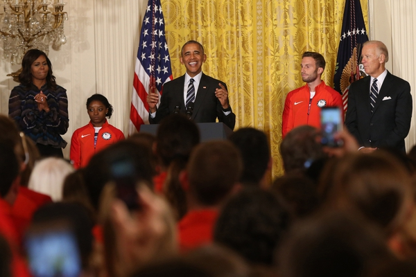 President Barack Obama speaks as (L-R) First Lady Michelle Obama, gymnast Simone Biles, paralympic soccer player Josh Brunais, and Vice President Joe Biden listen at a ceremony honoring the 2016 U.S. Olympic and Paralympic teams in the East Room at the White H ...