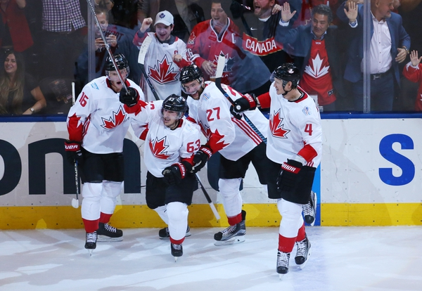 Team Canada center Brad Marchand (63) celebrates with teammates after scoring a short-handed goal against Team Europe during the third period in game two of the World Cup of Hockey final at Air Canada Centre.