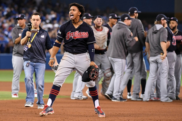 Cleveland Indians shortstop Francisco Lindor (12) celebrates beating the Toronto Blue Jays in game five of the 2016 ALCS playoff baseball series at Rogers Centre.