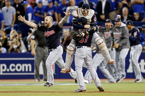 Cleveland Indians relief pitcher Cody Allen (37) and catcher Roberto Perez (55) celebrate after beating the Toronto Blue Jays in game five of the 2016 ALCS playoff baseball series at Rogers Centre.