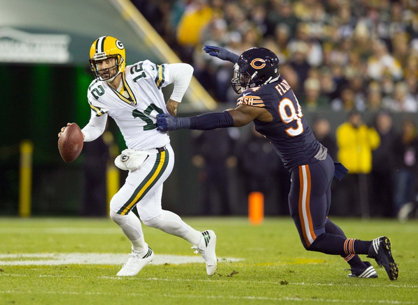 Chicago Bears linebacker Leonard Floyd (94) tries to tackle Green Bay Packers quarterback Aaron Rodgers (12) during the first quarter at Lambeau Field.