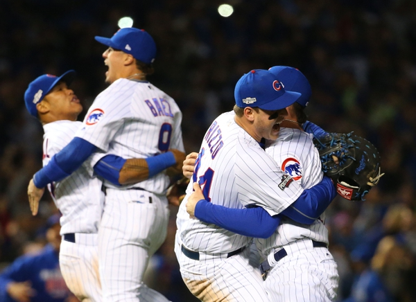 Chicago Cubs first baseman Anthony Rizzo (44), third baseman Kris Bryant (17), shortstop Addison Russell (27), and second baseman Javier Baez (9) celebrate defeating the Los Angeles Dodgers in game six of the 2016 NLCS playoff baseball series at Wrigley Field. ...