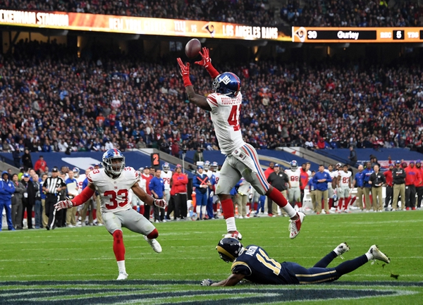 New York Giants cornerback Dominique Rodgers-Cromartie (41) intercepts a pass intended for Los Angeles Rams wide receiver Tavon Austin (11) as Giants free safety Andrew Adams (33) watches in the fourth quarter during game 16 of the NFL International Series at  ...