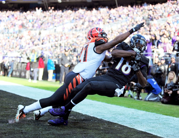 Baltimore Ravens wide receiver Breshad Perriman (18) catches a touchdown over Cincinnati Bengals cornerback Darqueze Dennard (21) in the first quarter at M&T Bank Stadium.