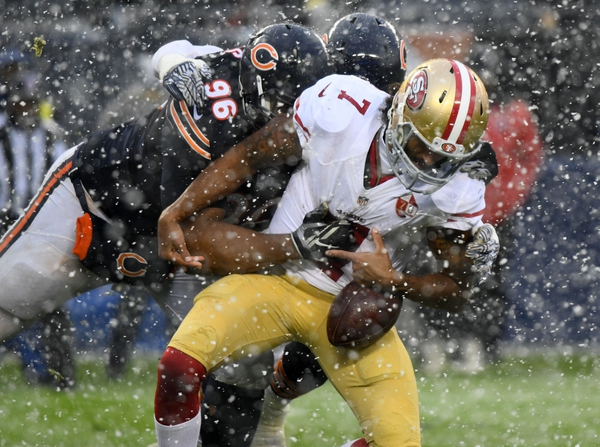 Chicago Bears defensive end Akiem Hicks (96) knocks the ball away from San Francisco 49ers quarterback Colin Kaepernick (7) during the second half at Soldier Field.